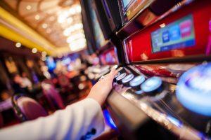 A lady playing casino slots